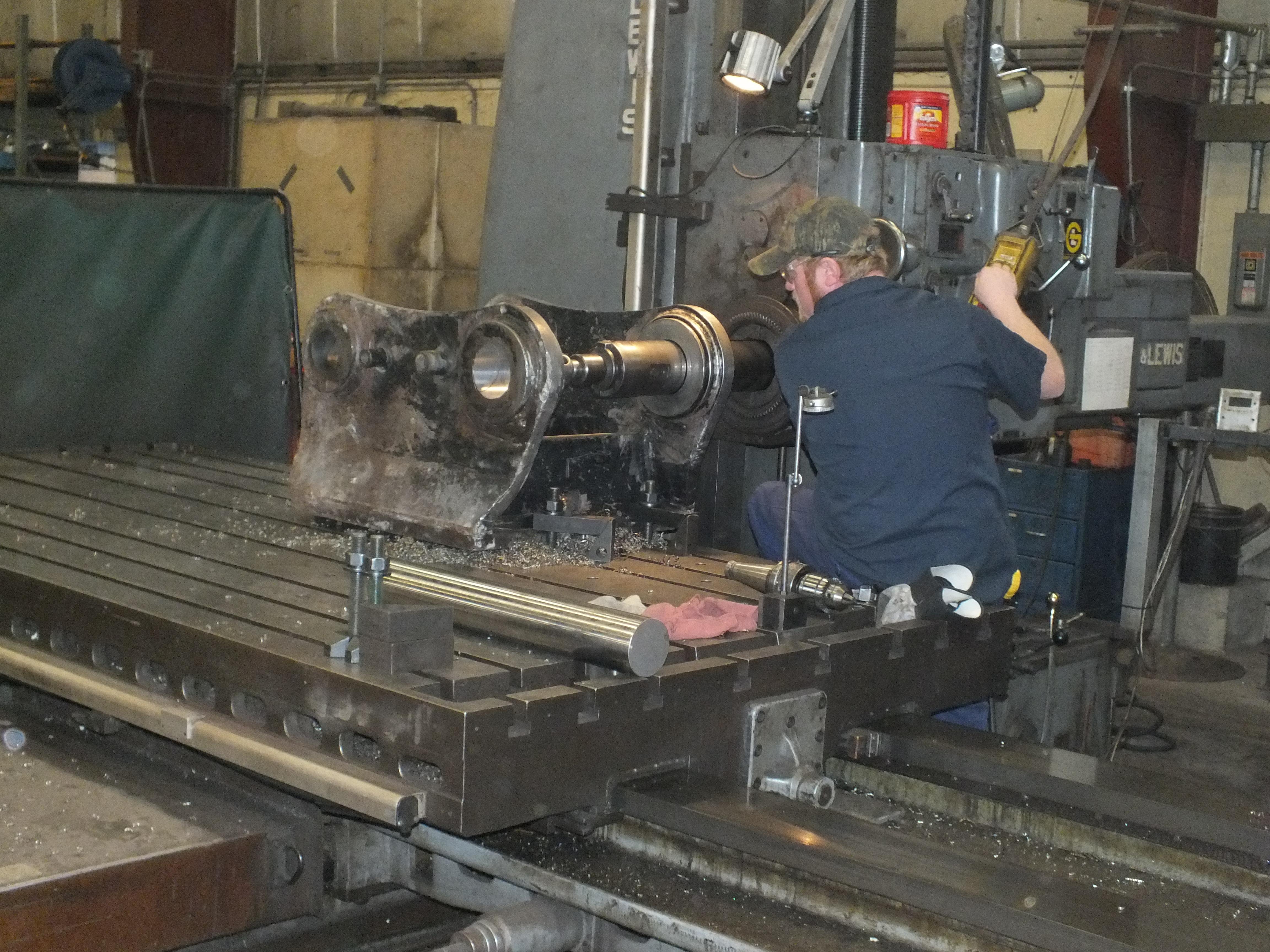 Machinery Maintenance employee prepping turning equipment